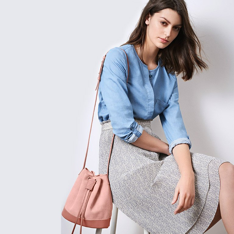 Look - Denim blouse, pleated skirt and small leather bag