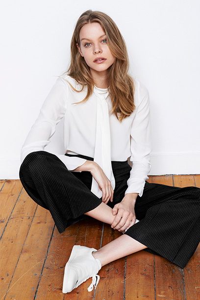 Woman look silk pussybow blouse and slash sneakers