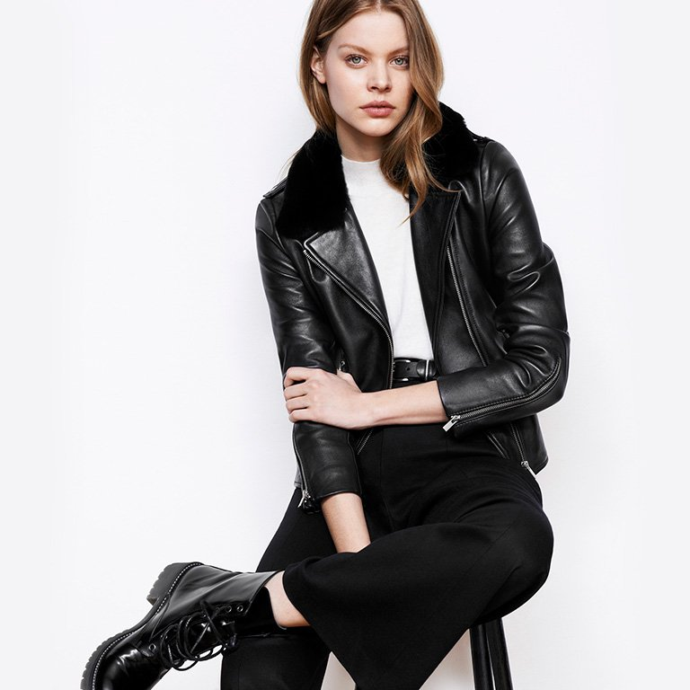 Woman look Leather biker and sleeveless jumper